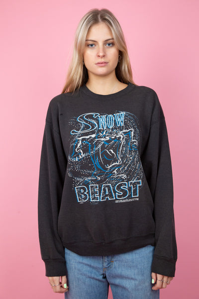 Faded black sweater with taz snow beast graphic on front -  magichollow