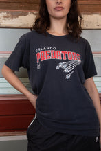Load image into Gallery viewer, model is wearing a university style graphic on the front showing a big cat clawing through the shirt. The tee is faded black model is wearing a university style graphic on the front showing a big cat clawing through the shirt. The tee is faded black