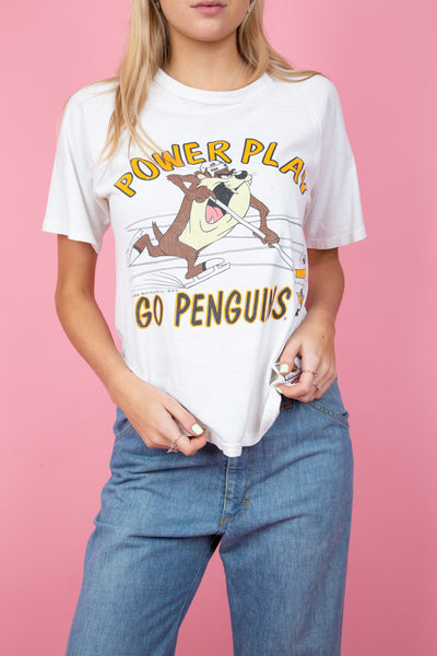 white single stitch tee with taz playing ice hockey on the front. NHL Penguins merch. magichollow