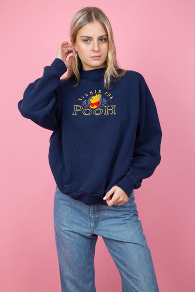 navy sweater with winnie the pooh embroidery on the front. magichollow
