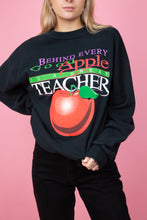 Load image into Gallery viewer, female model wearing a vintage black sweater with large apple front graphic