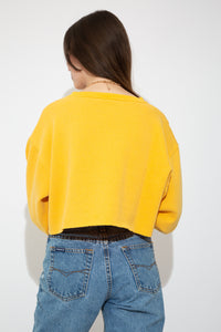 model wearing yellow cropped sweater, magichollow