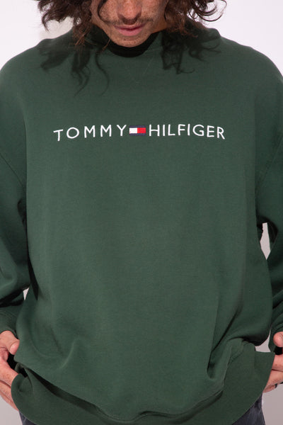 oversized green crew with embroidered tommy hilfiger text and flag across chest