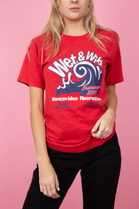 Female model in vintage red tee with a wet & wild graphic on the front