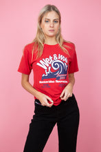 Load image into Gallery viewer, Female model in vintage red tee with a wet & wild graphic on the front