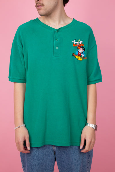 teal textured tee with embroidered disney characters