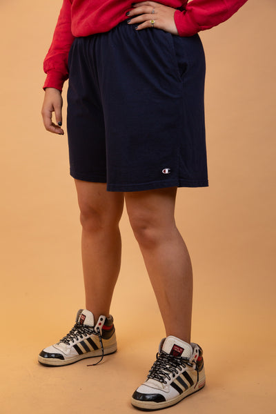 Navy blue in colour with branding on the left leg, soft material and an adjustable waistline