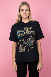female model in a vintage black New Orleans tee with peach detailing