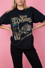 Load image into Gallery viewer, female model in a vintage black New Orleans tee with peach detailing