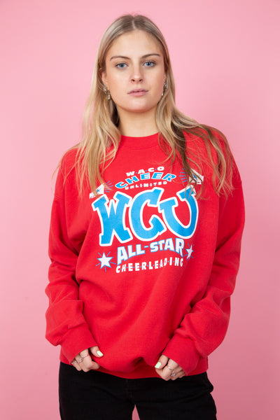 Female Model wearing a red waco cheerleading sweater