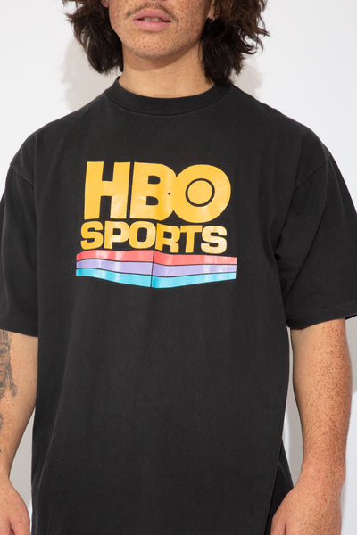 faded black tee with large HBO colourful graphic on front