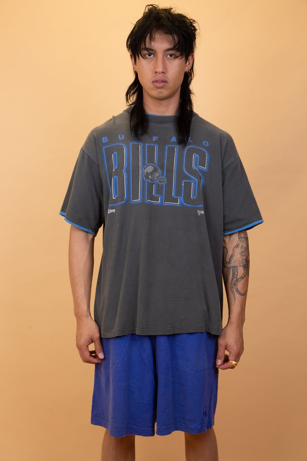 The model is wearing a Buffalo Bills tee which features the logo on the front
