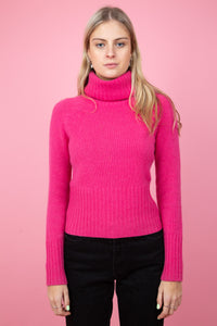 female model wearing vintage hot pink turtle neck cashmere sweater