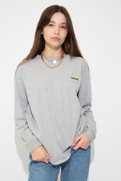 model wearing grey Adidas longsleeve, magichollow
