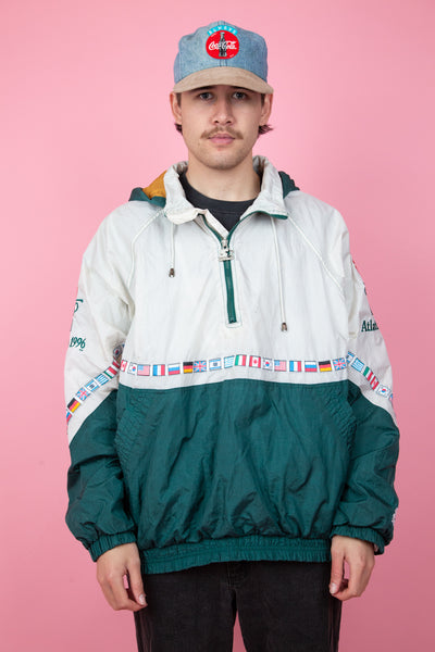 Green and white nylon pullover from 1996 atlanta olympics with embroidered detailing - vintage - magichollow