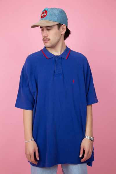 Blue vintage short sleeve polo. Red tipped collar. Small embroidered ralph lauren logo on the left side of the chest.