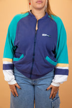 Load image into Gallery viewer, This navy zip-up has light blue sleeves with yellow and white horizontal stripes across the bottom of the sleeves, blue lined pockets and branding on the left chest.