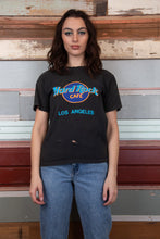 "Load image into Gallery viewer, faded black hard rock cafe tee with the iconic Hard Rock Cafe logo on the front and ""Los Angeles"" in blue and other colours. vintage top from magichollow"