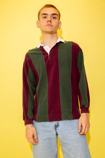 Maroon and dark green in colour, this rugby style sweater has vertical stripes with a white collar, white buttons and boxy fit.