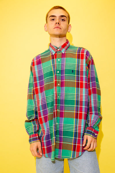 This must-have button up is in a colourful plaid design with white shell-like buttons down the front and on the cuffs and navy Ralph Lauren branding on the left chest.