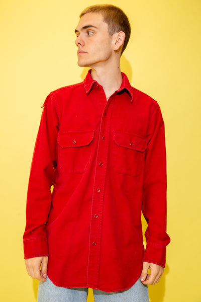 With its soft brushed cotton feel and thick material, this red button-up is a must-have for the colder seasons! With matching red buttons and double chest pockets.