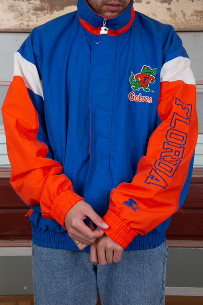 blue zip-up jacket with white and orange panels and embroidered florida gators detailing