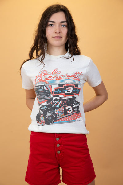 white tee with racing graphic on the front