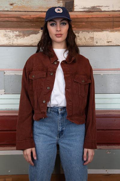 maroon cropped denim jacket with jokko logo at the bottom. magichollow