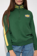 Load image into Gallery viewer, green quarterzip with oval embroidered detailing on left chest and contrasting yellow stripes on collar and down sleves