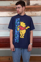 Load image into Gallery viewer, winnie the pooh tee in a navy blue colour-way. magichollow.