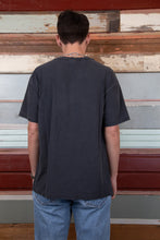 Load image into Gallery viewer, faded black tee with peace symbol graphic and text on front