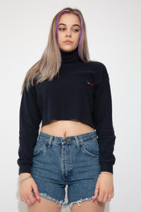 Navy blue Tommy Hilfiger turtle-neck tee with long sleeves. Cropped to keep it cute with Tommy Hilfiger branding on the folded-over neckline and on the left chest.