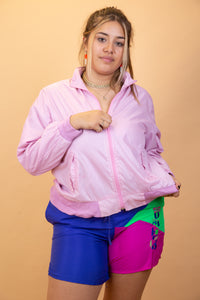 This zip-up is pink in colour with an anorak material, ribbed sleeves and waistline and a concealable zip-up hood.