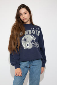 Model wearing cowboys sweater, magichollow