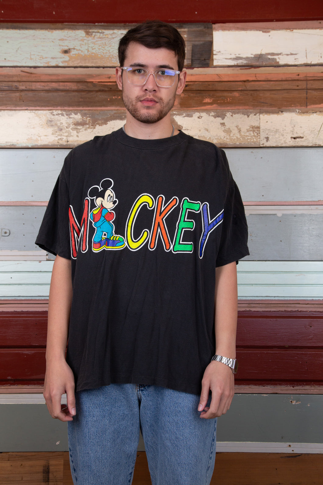 boxy black tee with vibrant mickey spell-out graphic across chest
