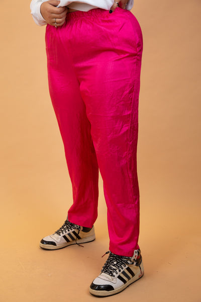 Bright fuscia pink pants with a loose flowy design, soft silky material and elasticated waistband.