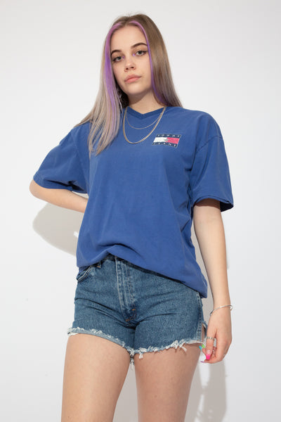 Indigo coloured Tommy Jeans tee with a v-neck cut and Tommy Jeans branding on the left chest and back.