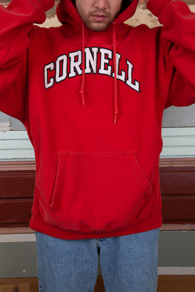 thick red hoodie with bold 'cornell' spell-out across chest
