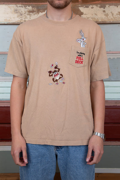 light-brown tee with embroidered looney characters playing poker on front