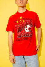 Load image into Gallery viewer, Bright red single-stitch tee with a large Nebraska Huskers print across the front, this tee reps the Fiesta Bowl with a helmet print, a sun print and dated 1996.