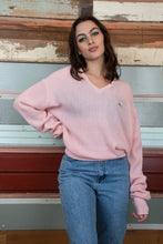 Load image into Gallery viewer, the model is wearing a pink knitted sweater is made by Lacoste, the knit fits oversized on the model.
