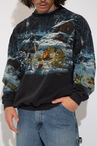 faded black crew with all over snowy campfire graphic across front, back and sleeves