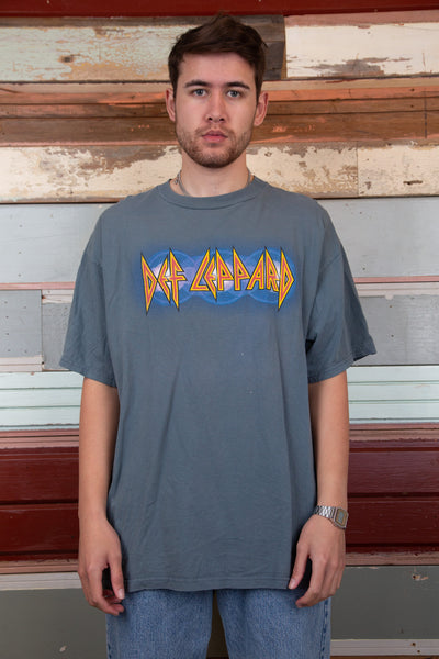 blue-grey tee with iconic Def Leppard logo spell-out across chest and concert locations from Euphoria tour on back
