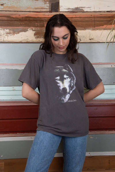 Brown/grey tee with a wolf on the front. magichollow