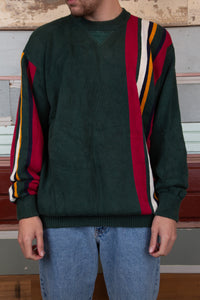 dark green knit with coloured vertical stripe detailing down left side and right sleeve