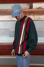 Load image into Gallery viewer, dark green knit with coloured vertical stripe detailing down left side and right sleeve