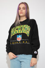 Load image into Gallery viewer, Black sweater with a large green and yellow Packers' print and 'Green Bay' printed below with the NFL logo. Dated 1994 with the Logo Athletic branding on the left sleeve.