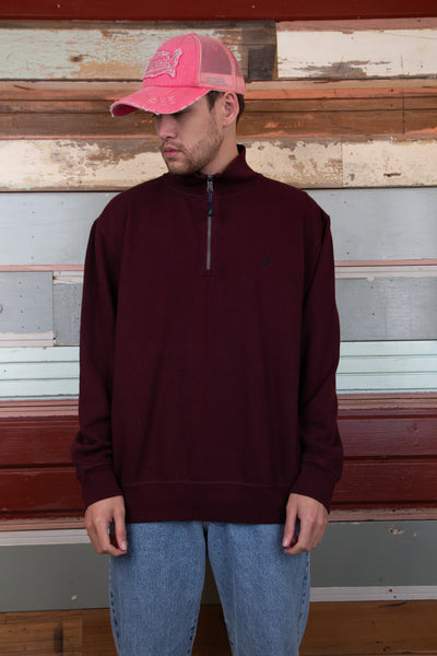 maroon quarterzip with embroidered nautica icon on left chest