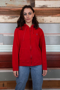 model is wearing a red zip up hooded sweater with a small embroidered Ralph Lauren logo which is blue logo