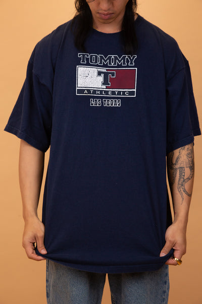 navy blue tee with Tommy Hilfiger athletics graphic on the front.